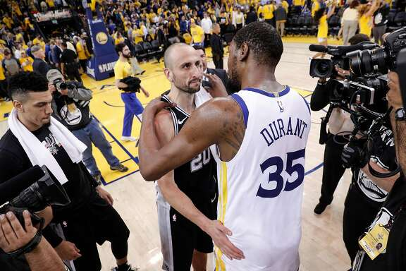 Golden State Warriors' Kevin Durant and San Antonio Spurs' Manu Ginobili speak after the Warriors defeated the Spurs 99 to 91 in game 5 of round 1 of the Western Conference Finals at Oracle Arena on Wednesday, April 25, 2018 in Oakland, Calif.