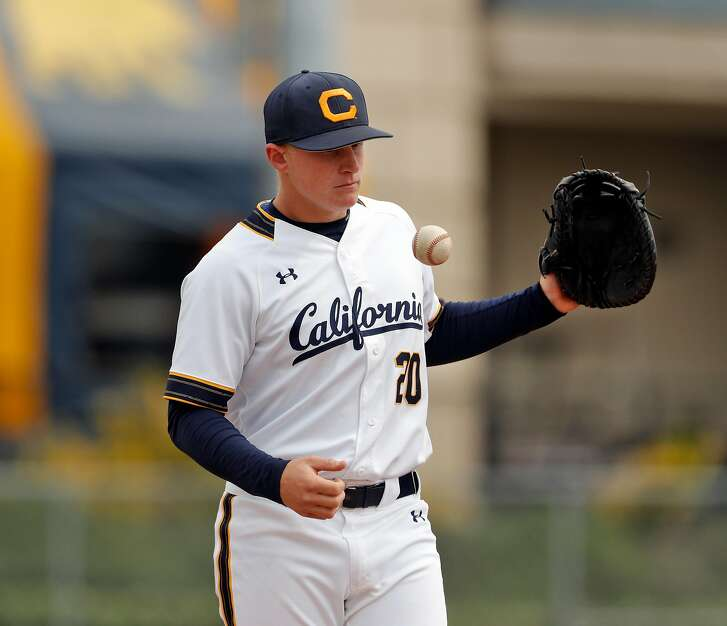 Andrew Vaughn (20) tosses a ball around before the fifth inning as the Cal Bears played the Oregon State Beavers at Evans Field in Berkeley, Calif., on Sunday, March 18, 2018.