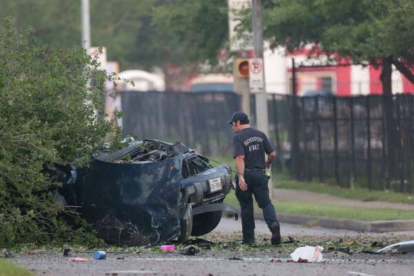 Authorities investigate the scene of a fatal vehicle crash on West Fuqua Street, near Bathurst Drive Wednesday, April 25, 2018, in Houston.