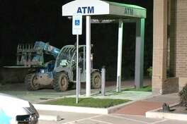 Thieves used a forklift to pry an ATM from its foundation at a bank early Wednesday, April 25, 2018, in the Memorial area.