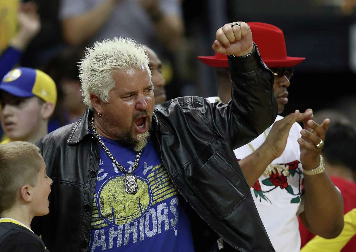 Celebrity chef Guy Fieri cheers for the Golden State Warriors during Game Five against the San Antonio Spurs of Round One of the 2018 NBA Playoffs at ORACLE Arena on April 24, 2018 in Oakland, California.
