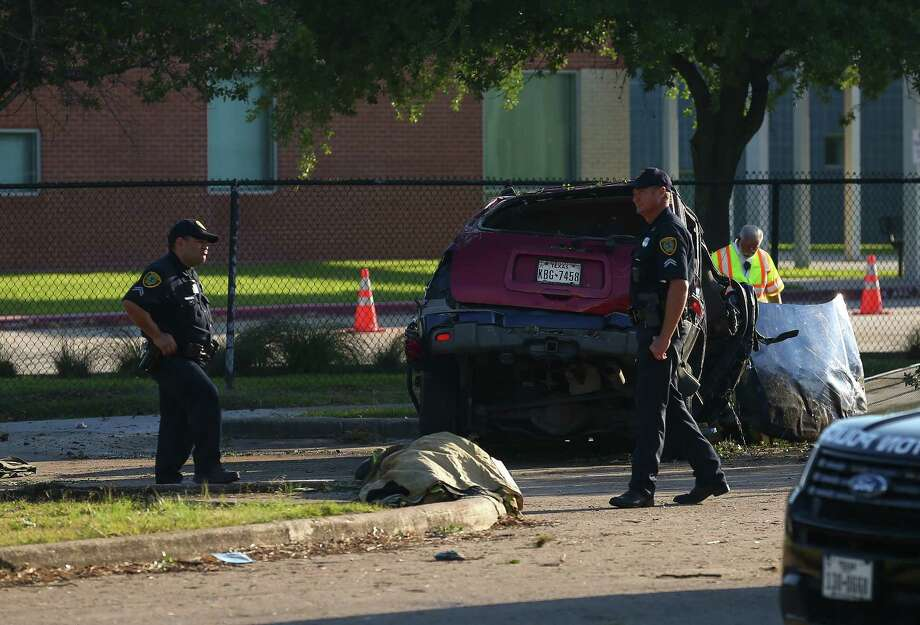 Houston Police Department investigates the scene of a two-vehicle fatal crash on West Fuqua Street, near Bathurst Drive Wednesday, April 25, 2018, in Houston. Two teenage boys were killed in the wreck. Photo: Godofredo A. Vasquez, Houston Chronicle
