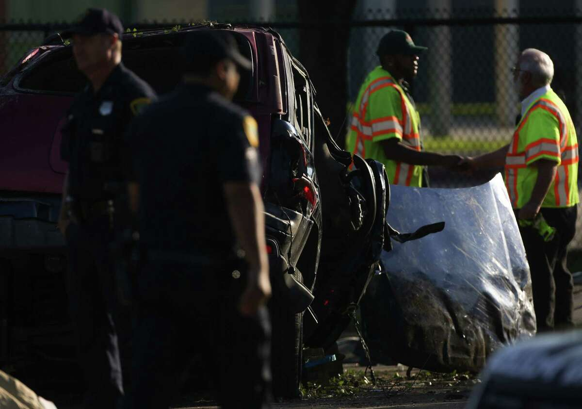 Houston Police Department investigates the scene of a two-vehicle fatal crash on West Fuqua Street, near Bathurst Drive Wednesday, April 25, 2018, in Houston. Two teenage boys were killed in the wreck.
