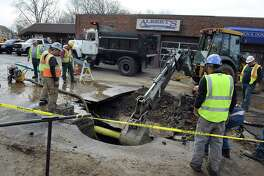 A severe break of a 16-inch water main has put much of Danbury under a water emergency on Tuesday, April 24, 2018. The broken water main is affecting operations at Danbury Hospital, closed two schools and left a third of the city without water or low water pressure. The break on Tamarack Avenue and Hayestown avenues that happened early Tuesday morning is affecting thousands of residents and scores of businesses.