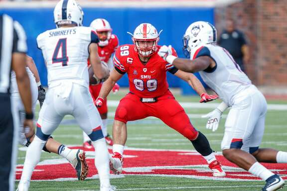 DALLAS, TX - SEPTEMBER 30: SMU Mustangs defensive end Justin Lawler (#99) rushes the quarterback during the college football game between the SMU Mustangs and the UConn Huskies on September 30, 2017 at Gerald J. Ford Stadium in Dallas, Texas.    (Photo by Matthew Visinsky/Icon Sportswire via Getty Images)
