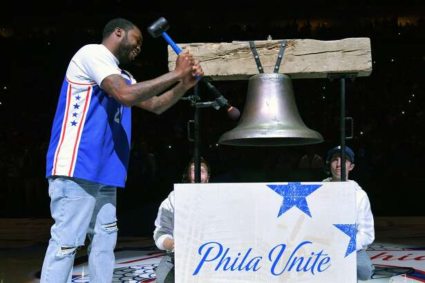 Entertainer Meek Mill rings a replica Liberty Bell before the game between the Philadelphia 76ers and Miami Heat at Wells Fargo Center on April 24, 2018 in Philadelphia, Pennsylvania.