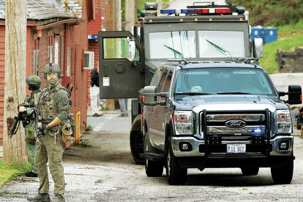 Alton Police and members of the ILEAS tactical team arrived on Quincy Court behind the building on Ridge Street with both the Alton and Madison County ballistic tactical vehicles during a raid last April. On Wednesday, ILEAS, along with Alton police and Illinois State Police, raided a house on West Ninth Street in Alton.