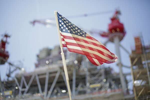 An American flag on top of a small vehicle flies in front of Shell's new Gulf deepwater platform, Appomattox, before it's set out to sea on Monday, April 23, 2018, in Ingleside. ( Elizabeth Conley / Houston Chronicle )