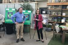 Gerald Nielsen, president of The Nielsen Company, receives the Going for Green Business Award from Darien Chamber of Commerce Executive Director Susan Cator.