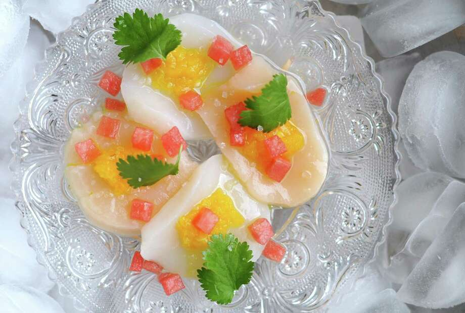 Scallops dressed with lime juice, diced watermelon and a splash of gin. Photo: Paul Stephen / San Antonio Express-News