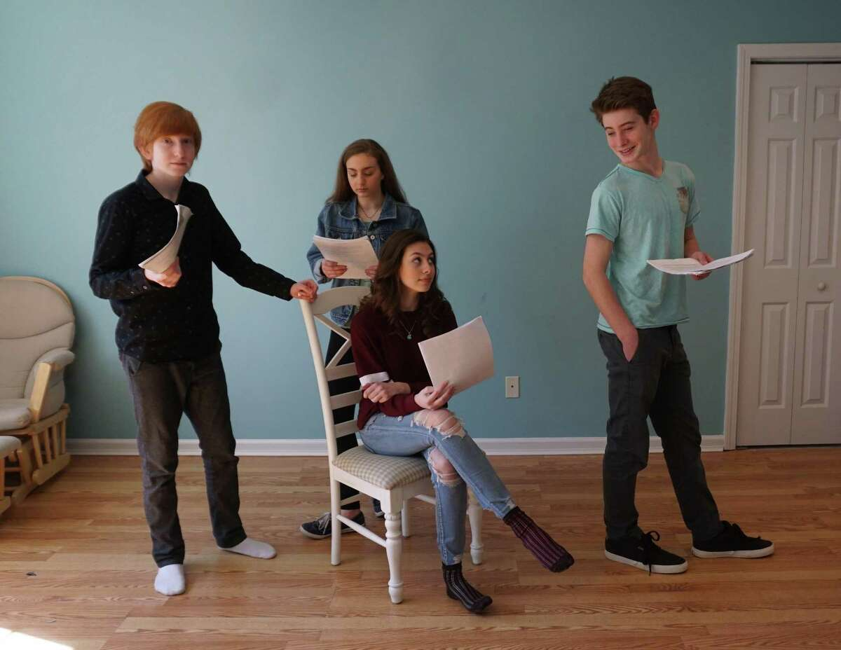 Students Liev Shpitalnik, Amelie Parczany, Dorian Hayes (seated) and Bella Rarick read a play.