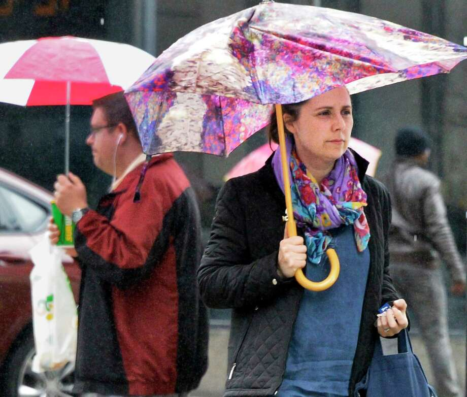 Amelia Looby of Guilderland makes her way through today's rain on her way home from work Wednesday April 25, 2018 in Albany, NY.  (John Carl D'Annibale/Times Union) Photo: John Carl D'Annibale, Albany Times Union / 40043603A