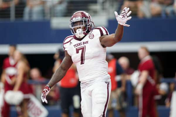 ARLINGTON, TX - SEPTEMBER 23: Texas A&M Aggies running back Keith Ford (#7) celebrates a touchdown during the college football game between the Arkansas Razorbacks and Texas A&M Aggies on September 23, 2017 at AT&T Stadium in Arlington, Texas.  Texas A&M won the game 50-43 in overtime.  (Photo by Matthew Visinsky/Icon Sportswire via Getty Images)