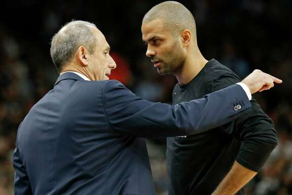 San Antonio Spurs assistant coach Ettore Messina talks with guard Tony Parker (9) during first half action against the Golden State Warriors Thursday April 19, 2018 at the AT&T Center.