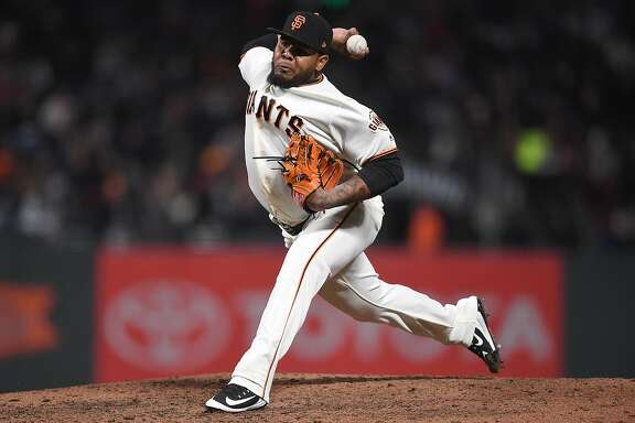 SAN FRANCISCO, CA - APRIL 24:  Reyes Moronta #54 of the San Francisco Giants pitches against the Washington Nationals in the top of the six inning at AT&T Park on April 24, 2018 in San Francisco, California. The Giants won the game 4-3.  (Photo by Thearon W. Henderson/Getty Images)
