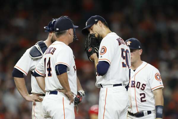 Houston Astros starting pitcher Charlie Morton (50) is pulled by manager AJ Hinch (14) during the fifth inning of an MLB game at Minute Maid Park, Tuesday, April 24, 2018, in Houston. ( Karen Warren  / Houston Chronicle )
