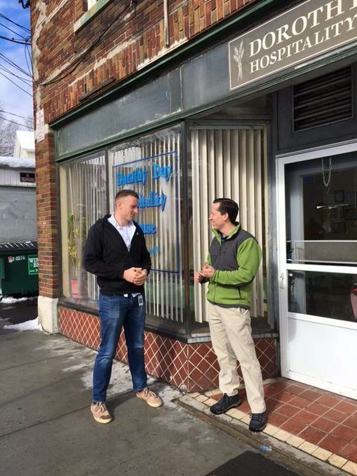 WCHN High Risk Navigators Justin Cullmer and Kevin McVeigh check in on clients after another cold spell outside the Dorothy Day Hospitality House Shelter and Meal Program in Danbury.