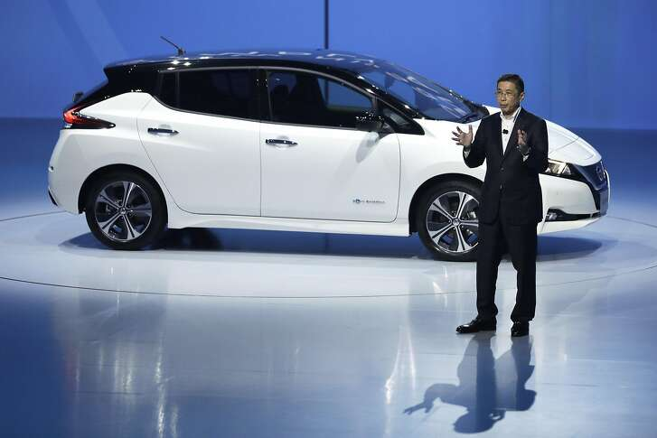 FILE: Hiroto Saikawa, president and chief executive officer of Nissan Motor Co., speaks in front of the company's new Leaf electric vehicle (EV) at the unveiling in Chiba, Japan, on Wednesday, Sept. 6, 2017. Renault SA and Nissan Motor Co. are in talks to merge, seeking to solidify their two-decade-old alliance under a single stock as an unprecedented shift toward electric and shared cars transforms the industry, people with knowledge of the matter said. Our editors select the best archive images on the two companies. Photographer: Kiyoshi Ota/Bloomberg