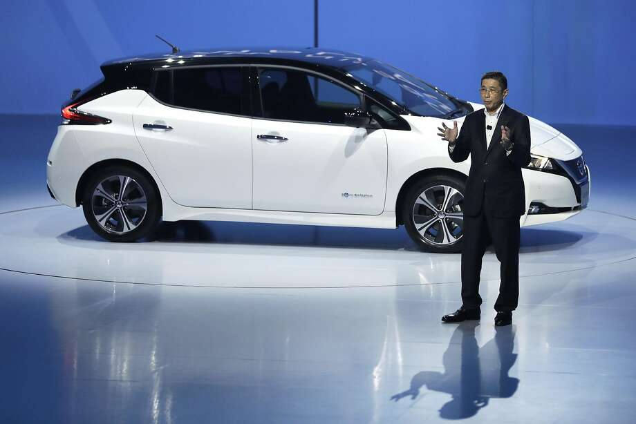 Hiroto Saikawa, president and CEO of Nissan Motor Co., speaks in front of the company's new Leaf at the unveiling in Chiba, Japan, last September. Photo: Kiyoshi Ota / Bloomberg 2017