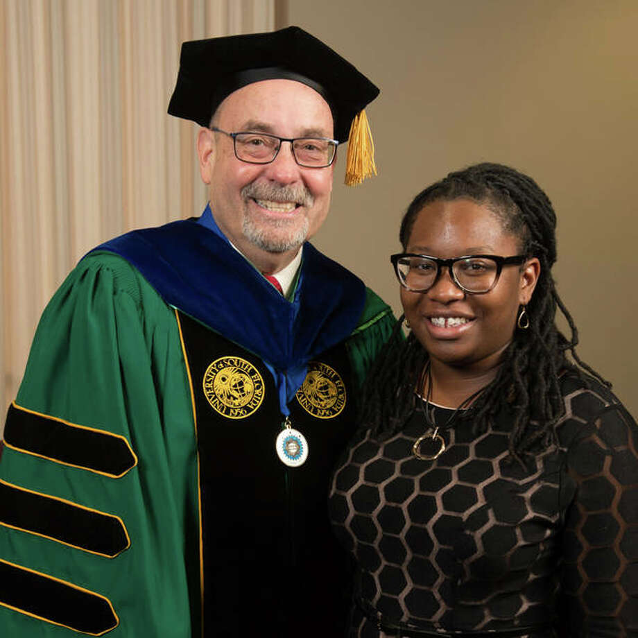 CAS Dean Greg Budzban stands with CAS Honors Day student speaker Tanadja Barber. Photo:       For The Telegraph