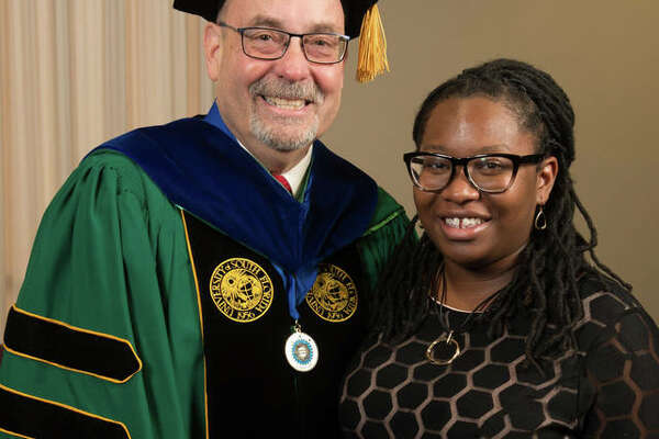 CAS Dean Greg Budzban stands with CAS Honors Day student speaker Tanadja Barber.