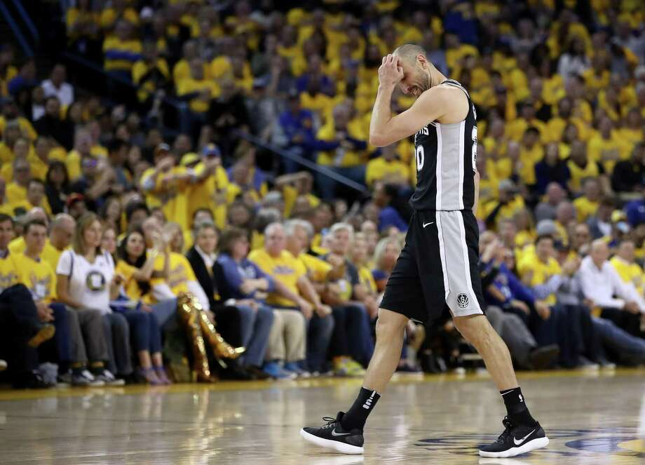 OAKLAND, CA - APRIL 24:  Manu Ginobili #20 of the San Antonio Spurs reacts after turning over the ball against the Golden State Warriors during Game Five of Round One of the 2018 NBA Playoffs at ORACLE Arena on April 24, 2018 in Oakland, California.  NOTE TO USER: User expressly acknowledges and agrees that, by downloading and or using this photograph, User is consenting to the terms and conditions of the Getty Images License Agreement.  (Photo by Ezra Shaw/Getty Images) Photo: Ezra Shaw, Staff / Getty Images / 2018 Getty Images