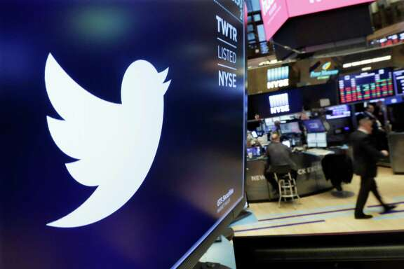 FILE- In this Feb. 8, 2018, file photo the logo for Twitter is displayed above a trading post on the floor of the New York Stock Exchange. The company on Wednesday posted only its second profitable quarter and despite some strong growth overseas, many on Wall Street remain jittery about its prospects.