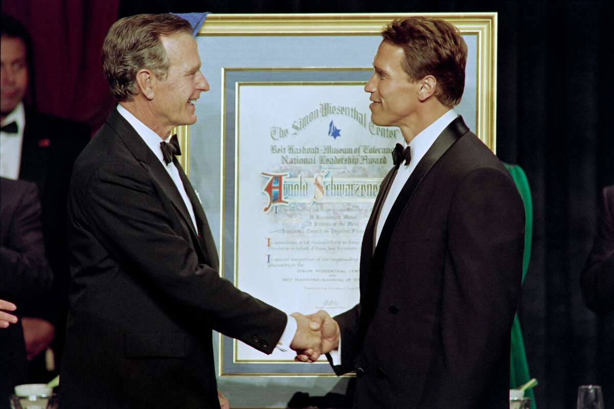 President George Bush congratulates Arnold Schwarzenegger after presenting him with the Simon Wiesenthal Center's National Leadership Award in Los Angeles on June 16, 1991.