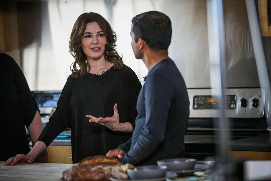 Cookbook author and television personality Nigella Lawson chats with Chronicle columnist Nik Sharma (right) during a Facebook Live video. Photo: Gabrielle Lurie / The Chronicle