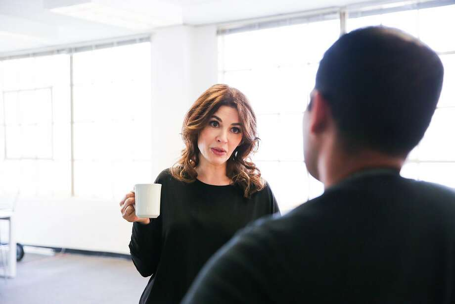 Cookbook author and television personality Nigella Lawson chats with Chronicle columnist Nik Sharma (right) in the Chronicle test kitchen. Photo: Photos By Gabrielle Lurie / The Chronicle