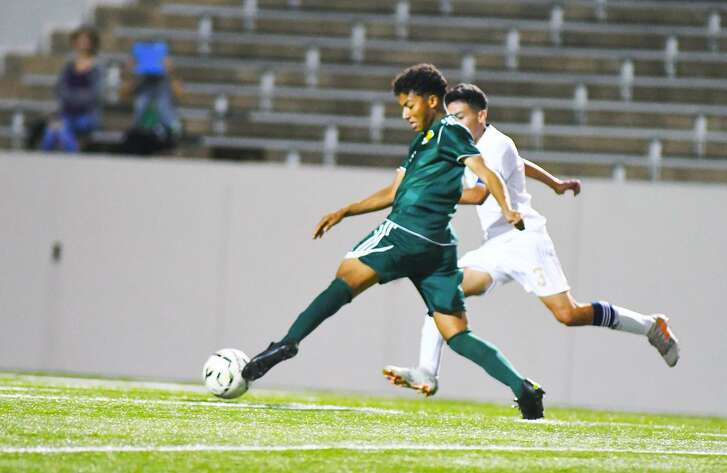 Forward Jacob Mejia Romero (9) maneuvers the ball though the Nimitz defense in a payoff game, March 29, at Thorne Stadium, had the third greatest impact offensively for head coach Roger Ramirez.