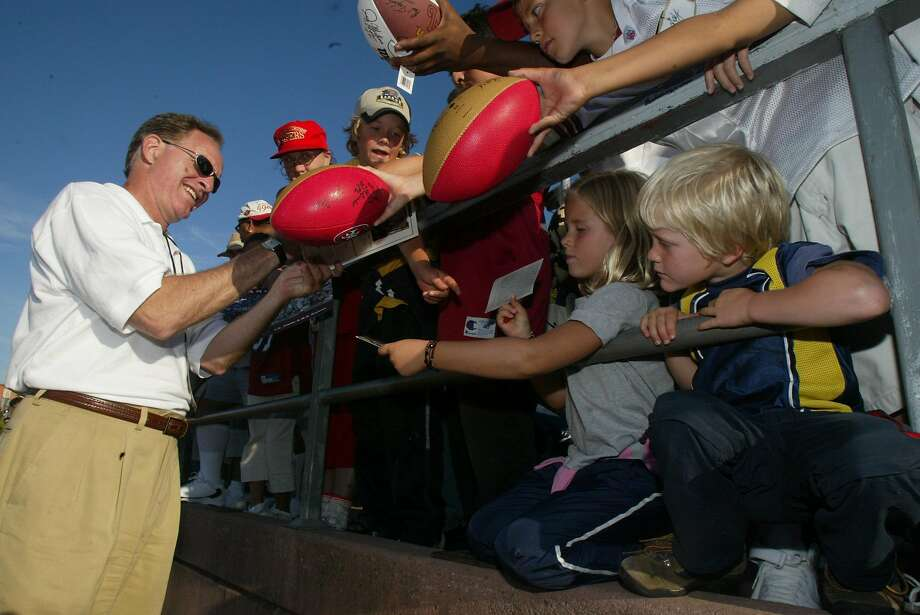 Fans get autographs from former player Mike Shumann, who was a wide receiver form 1977 to 1982.