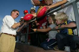 Fans get autographs from former player Mike Shumann, who was a wide receiver form 1977 to 1982.  The San Francisco 49ers practice at Kezar Stadium, which was free to the public on Aug 25th, 2003. Overveiw from the top of the stadium. Liz Mangelsdorf/ The Chronicle