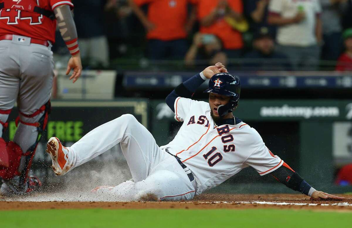 Houston Astros first baseman Yuli Gurriel (10) scores off Alex Bregman's three-RBI double during the fourth inning of an MLB game against the Los Angeles Angels at Minute Maid Park Wednesday, April 25, 2018, in Houston.