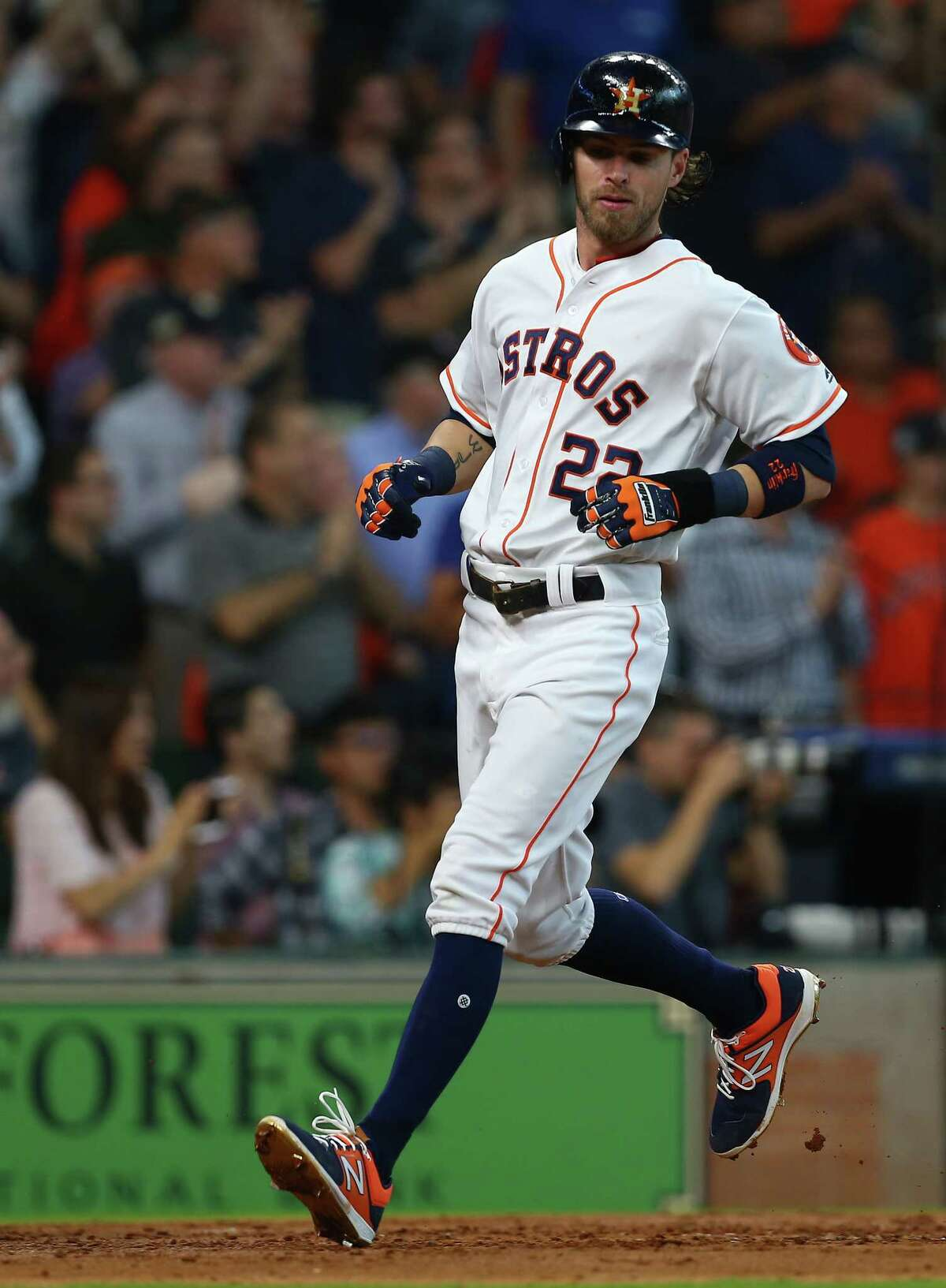 Houston Astros right fielder Josh Reddick (22) scores off Alex Bregman's three-RBI double during the fourth inning of an MLB game against the Los Angeles Angels at Minute Maid Park Wednesday, April 25, 2018, in Houston.