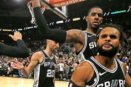 SAN ANTONIO,TX - APRIL 22 :  Manu Ginobili #20, LaMarcus Aldridge and Patty Mills #8 of the San Antonio Spurs celebrate after winning Game Four of Round One of the 2018 NBA Playoffs against the Golden State Warriors at AT&T Center on April 22 , 2018  in San Antonio, Texas.  NOTE TO USER: User expressly acknowledges and agrees that , by downloading and or using this photograph, User is consenting to the terms and conditions of the Getty Images License Agreement. (Photo by Ronald Cortes/Getty Images)
