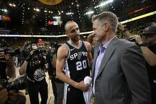 OAKLAND, CA - APRIL 24:  Manu Ginobili #20 of the San Antonio Spurs talks to head coach Steve Kerr of the Golden State Warriors after the Warriors beat the Spurs in Game Five of Round One of the 2018 NBA Playoffs at ORACLE Arena on April 24, 2018 in Oakland, California.  NOTE TO USER: User expressly acknowledges and agrees that, by downloading and or using this photograph, User is consenting to the terms and conditions of the Getty Images License Agreement.  (Photo by Ezra Shaw/Getty Images)