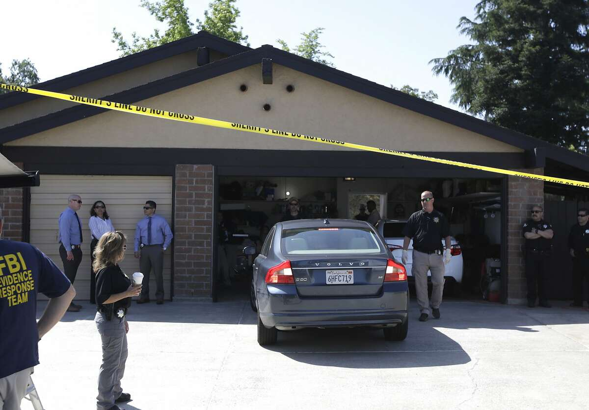 A car is backed out of the garage of a home searched in connection with the arrest of a man on suspicion of murder, Wednesday, April 25, 2018, in Citrus Heights, Calif. The Sacramento County District Attorney's Office plans to make a major announcement in the case of a serial killer they say committed at least 12 homicides, 45 rapes and dozens of burglaries across California in the 1970's and 1980s. (AP Photo/Rich Pedroncelli)