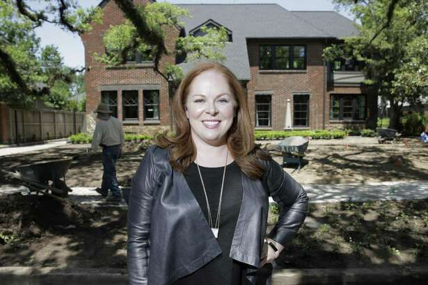 Designer Laura Umansky stands in front of her North Boulavard home as it is readied for a tour benefitting Preservation Houston. Umansky is in the process of moving into the home, that was built in 1925.