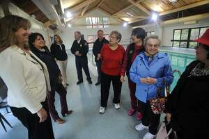 From left; Stratford Mayor Laura Hoydick and Public Works Deputy Director Raynae Serra talk with Ella Grasso Center pool users Carol Bradley, Zoe Ward, Mary Memoli, and Josie Gaspar at the ceremony announcing the pool's re-opening to the public in Stratford, Conn. on Wednesday, April 25, 2018.