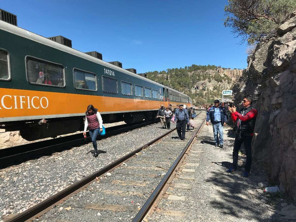 Passengers walk alongside the