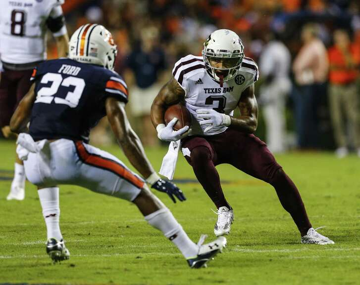AUBURN, AL - SEPTEMBER 17:  Wide receiver Christian Kirk #3 of the Texas A&M Aggies carries the ball against the Auburn Tigers during an NCAA college football game on September 17, 2016 in Auburn, Alabama. (Photo by Butch Dill/Getty Images)