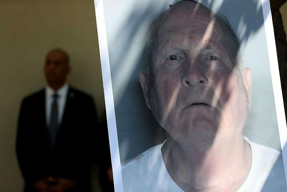 A photo of accused rapist and killer Joseph James DeAngelo is displayed during a news conference on April 25, 2018 in Sacramento, California. Sacramento district attorney Anne Marie Schubert was joined by law enforcement officials from across California to announce the arrest of 72 year-old Joseph James DeAngelo who is believed to be the the East Area Rapist, also known as the Golden State Killer, who killed at least 12, raped over 45 people and burglarized hundreds of homes throughout California in the 1970s and 1980s. (Photo by Justin Sullivan/Getty Images)