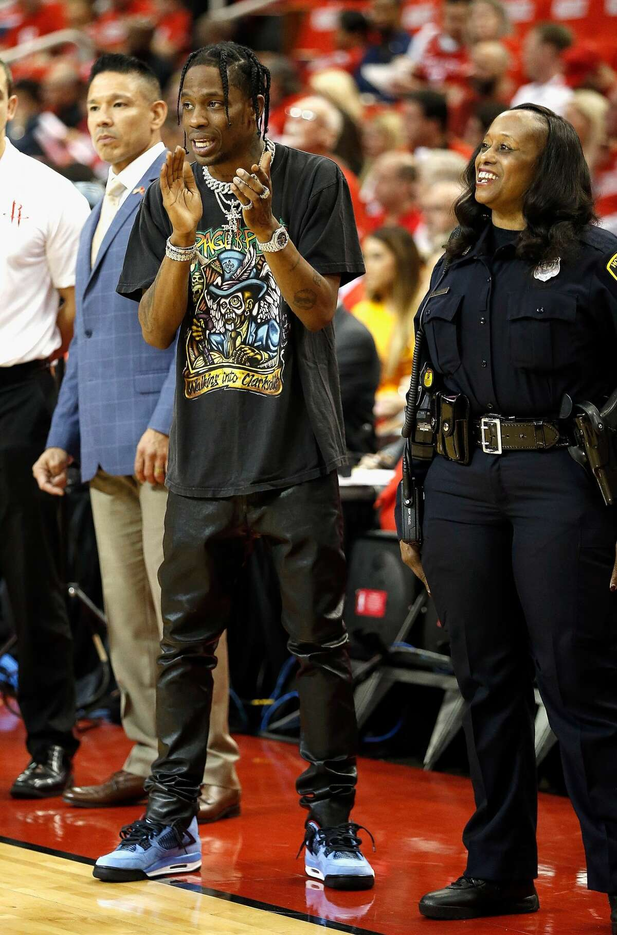 Houston rapper Travis Scott looks on during Game Two of the first round of the Western Conference playoffs at Toyota Center.
