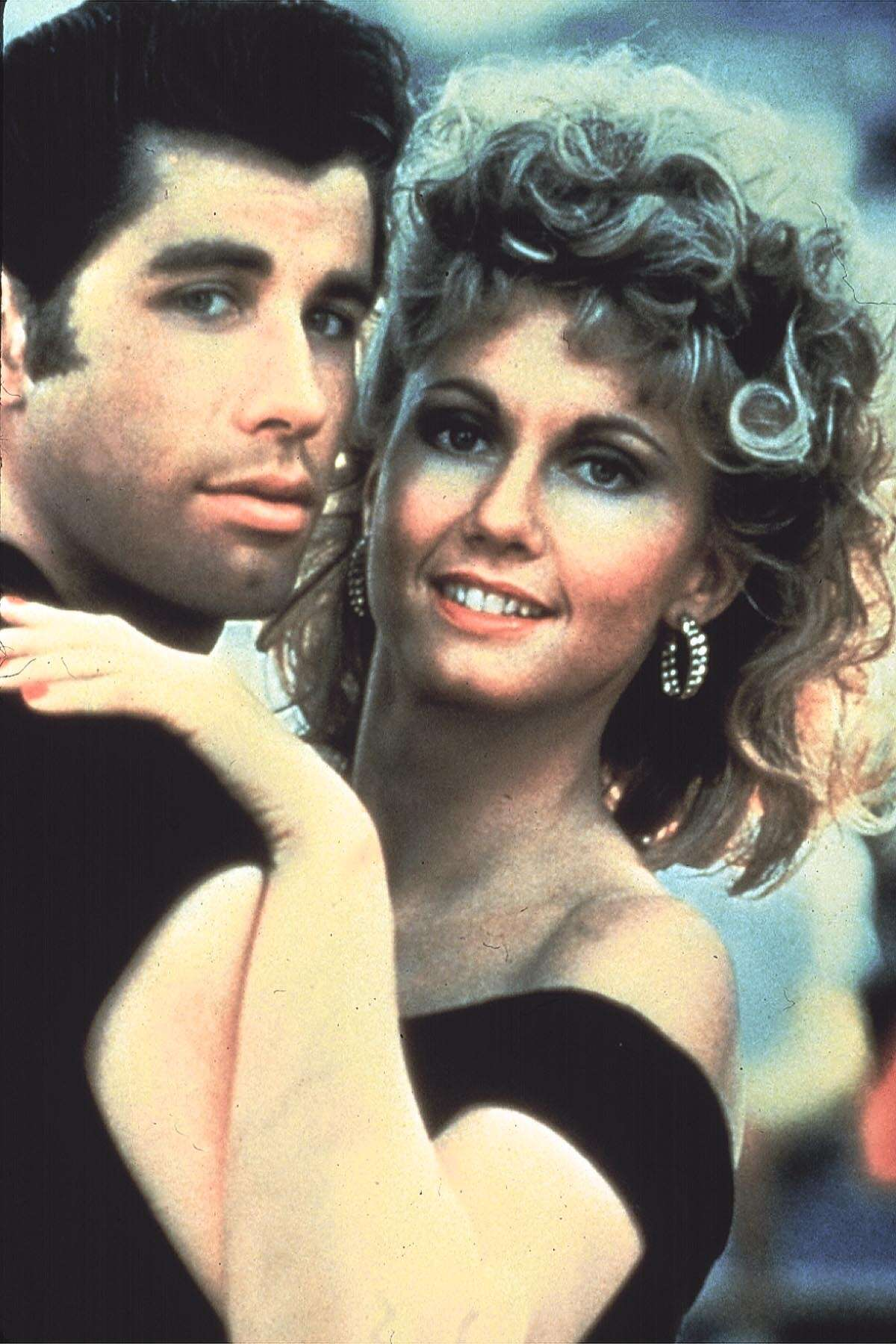 MV0135600000 1231_17 TNT 01-01-2001 8:00 PM Grease Best Bet John Travolta and Olivia Newton-John play high-schoolers reunited after a summer fling in the musical movie ''Grease,'' Monday, Jan. 1 (8-10:30 p.m. ET) on TNT. 4x6 Color 72dpi Photos-Jay