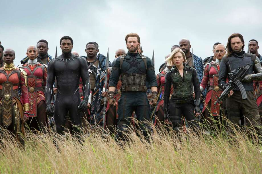 "This image released by Marvel Studios shows, front row from left, Danai Gurira, Chadwick Boseman, Chris Evans, Scarlet Johansson and Sebastian Stan in a scene from ""Avengers: Infinity War,"" premiering on April 27. (Chuck Zlotnick/Marvel Studios via AP) Photo: Chuck Zlotnick / null"