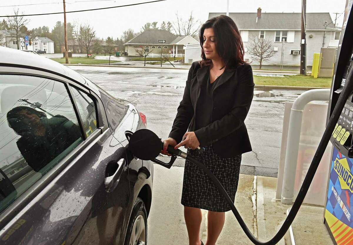 Gina Boilard of Rotterdam fills the gas tank in her car at a Sunoco gas station on Wednesday April 25, 2018 in Rotterdam, N.Y. (Lori Van Buren/Times Union)
