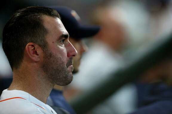 Houston Astros starting pitcher Justin Verlander (35) sits in the dugout during the bottom of the seventh inning of an MLB game against the Los Angeles Angels at Minute Maid Park Wednesday, April 25, 2018, in Houston. Verlander pitched seven innings while striking up nine Anges batters. He gave up two runs on four hits.