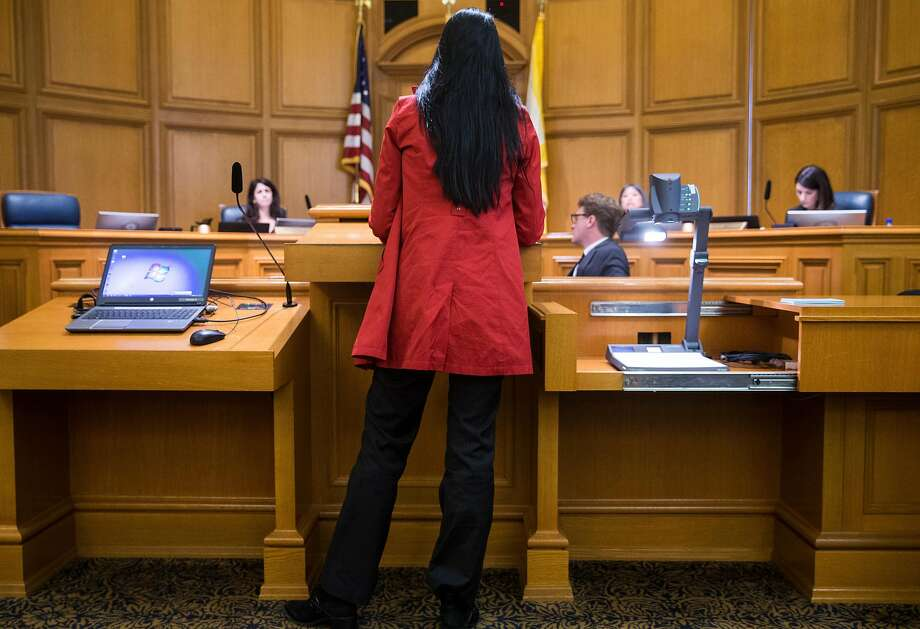 "Rachel Sutton speaks about her experience reporting a sexual assault, describing what she called ""negligence and incompetence,"" during a Board of Supervisors committee hearing. Photo: Jessica Christian / The Chronicle"