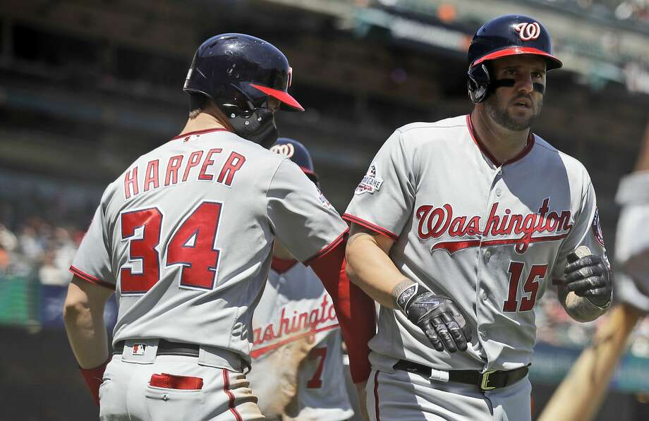 Washington Nationals' Matt Adams, right, is met at home plate by teammate Bryce Harper after Adams' three-run home run against the San Francisco Giants during the fourth inning of a baseball game Wednesday, April 25, 2018, in San Francisco. (AP Photo/Marcio Jose Sanchez) Photo: Marcio Jose Sanchez / Associated Press